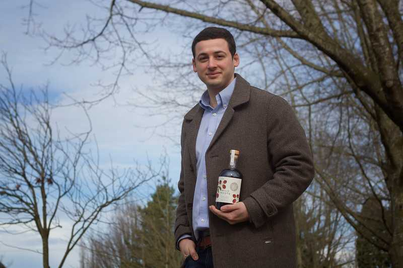 by: TIMES PHOTO: JONATHAN HOUSE - Chris Joseph of Wild Roots Vodka is moving some of his production from Bend to Beaverton.