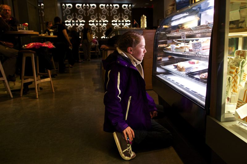 by: TRIBUNE PHOTOS: JAIME VALDEZ - Lydia Chilton, 11, eyes the desserts at the second Pacific Pie Company (above), which is also part of the new Benevento building (below) on Northwest 23rd Avenue.
