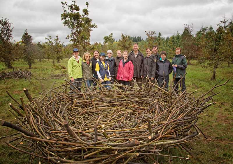 by: COURTESY OF BJORN FREDRICKSON - BIG BIRD - Last fall members of the Friends of the Tualatin River National Wildlife Refuge along with U.S. Fish & Wildlife staff celebrated the completion of an eagle's nest sculpture to symbolize the Friends group.