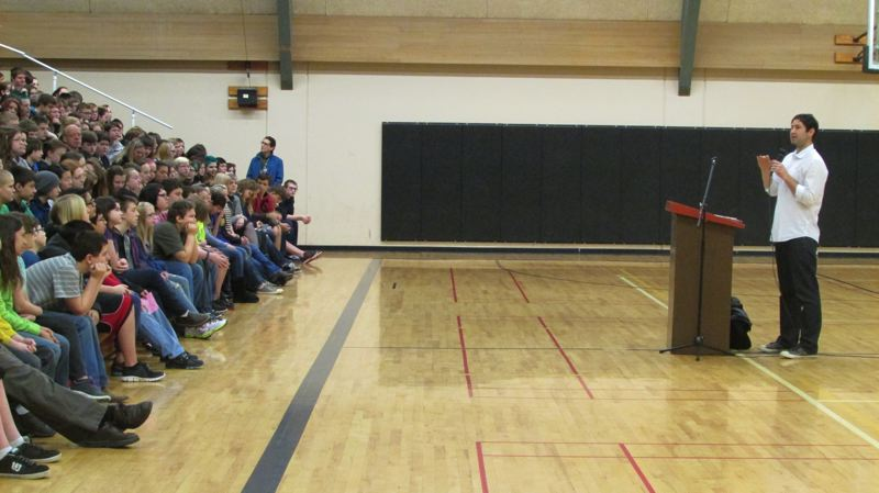 by: MARK MILLER - Young adult author Matt de la Pena speaks to a student assembly in the St. Helens Middle School gymnasium Monday, Feb. 24. Principal Carol Dowsett said students raised money to bring de la Pena, whose most recent book 'The Living' was published last year, to the school.