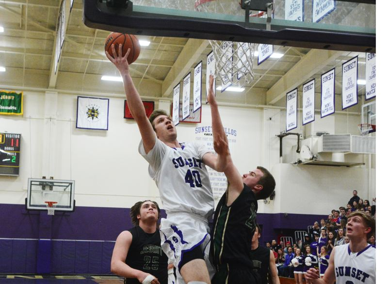 by: TIMES PHOTO: MATT SINGLEDECKER - Sunset senior post Tyler Gutierrez scored 12 points for the Apollos who snapped Jesuits five-year run of Metro Championships on Wednesday.