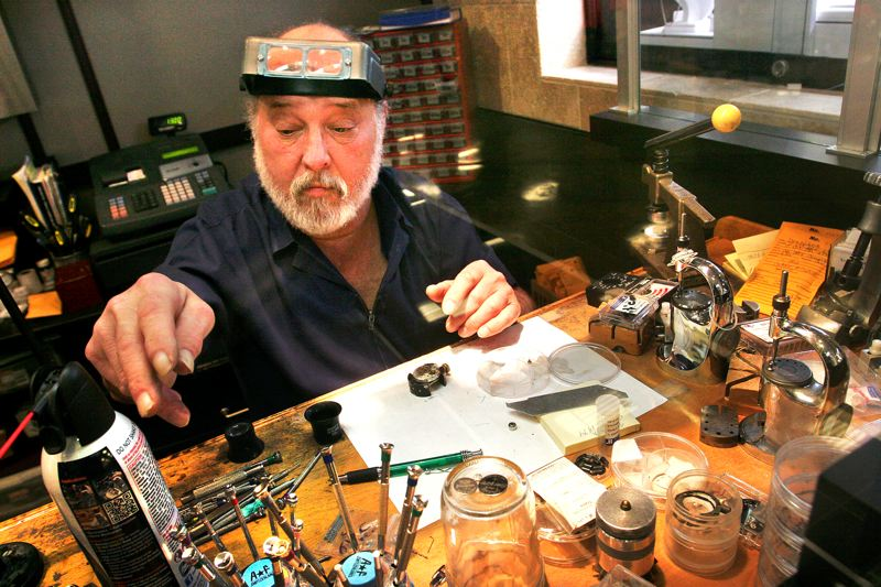 by: OUTLOOK PHOTO: JIM CLARK - Leon Abel recognizes that watchmakers are disappearing and, as a result, his expertise is in high demand.