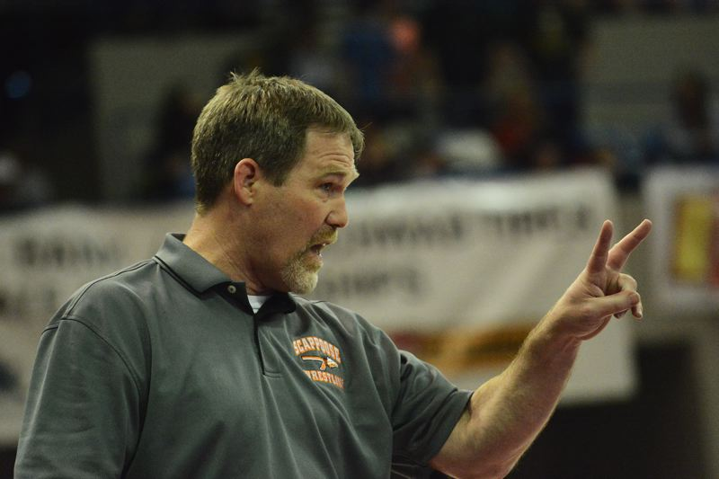 by: JOHN WILLIAM HOWARD - Head coach Jim Jones and the Scappoose wrestling program are breathing down the necks of second-place Henley at the 2014 OSAA wrestling state championships.