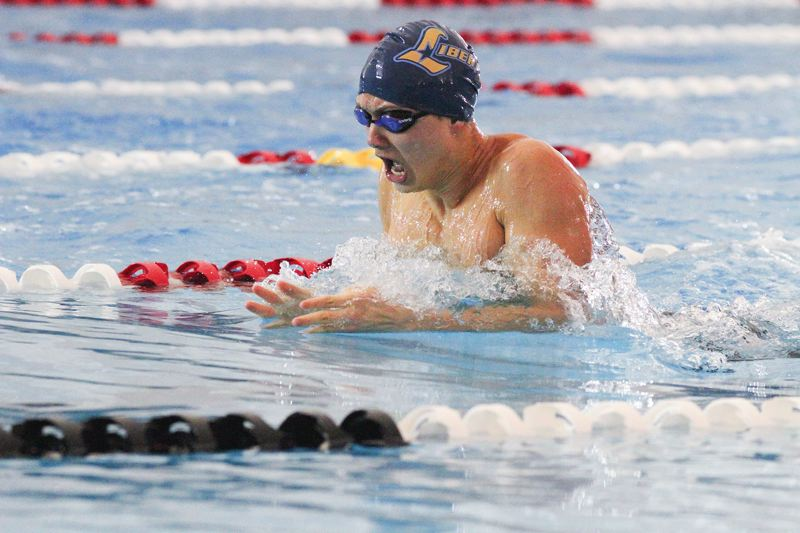 by: HILLSBORO TRIBUNE PHOTO: AMANDA MILES - Liberty's Daniel Lupro swims to a fourh-place finish in the 100-yard breaststroke Saturday.