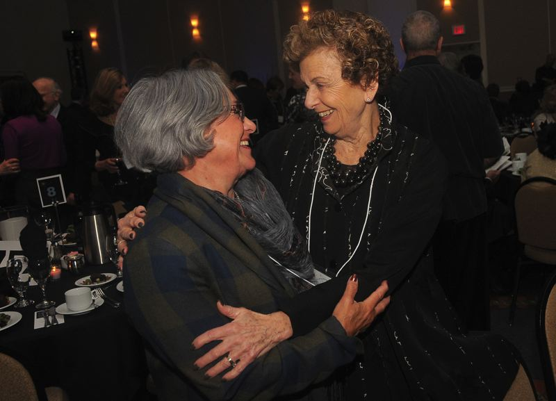 by: CONNECTION PHOTO: VERN UYETAKE - Joyce Loeb and Shirley Rackner give each other a big hug.