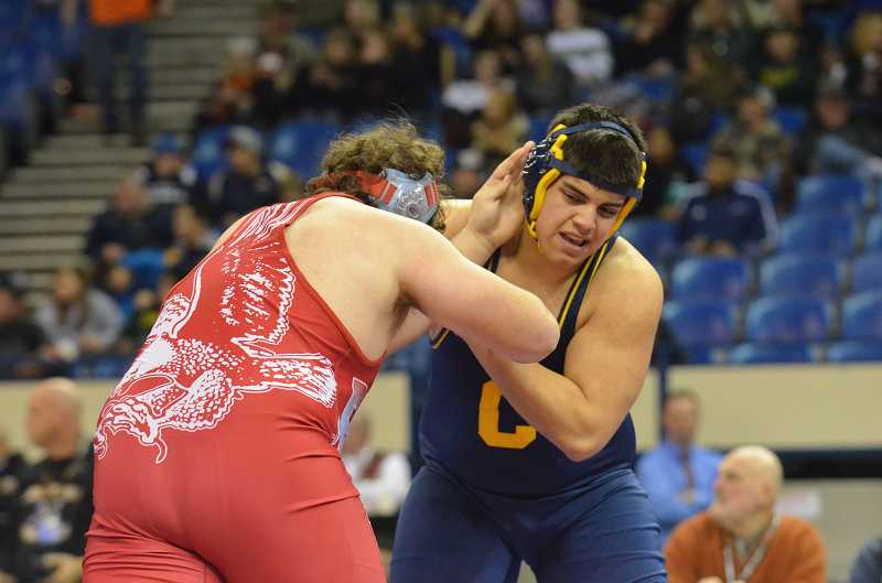 by: JEFF GOODMAN / PAMPLIN MEDIA GROUP - Canby senior Alejandro Sandoval took second place in the heavyweight division at the Class 6A state championships March 1 at Veterans Memorial Coliseum in Portland, losing in overtime to Centennial senior Michael McGuire.