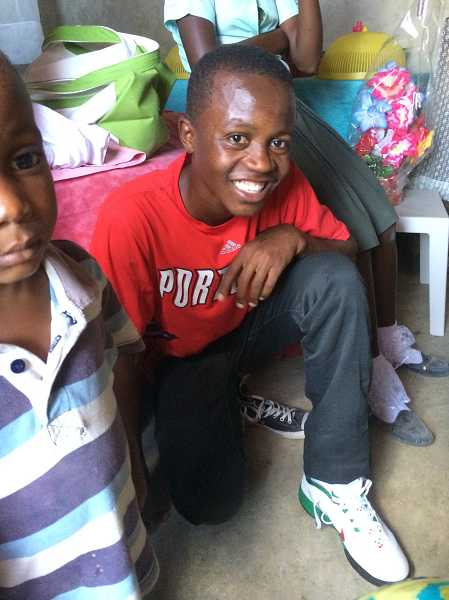by: SUBMITTED PHOTO - A Haitian boy shows off his new pair of Nike shoes.