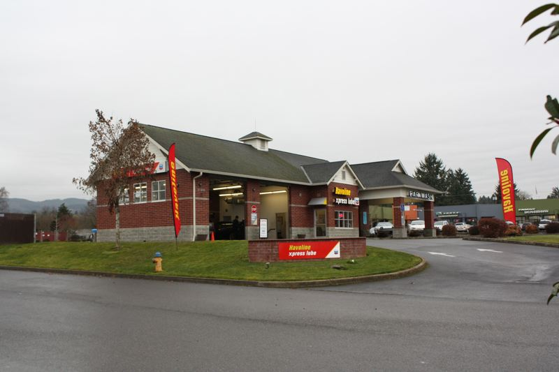 by: FILE PHOTO - The Scappoose Automobilia Quick Lube and Car Wash paid $14,400 in DEQ penalties Feb. 27 for dumping more than 6,500 gallons of a water and oil mix into a storm drain in 2012.