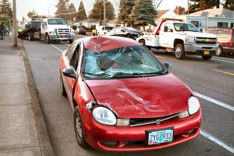 by: DAVID F. ASHTON - Using this Dodge Neon like a ramp, hit-and-run car drove up its hood, and almost over the top, pushing it backward.