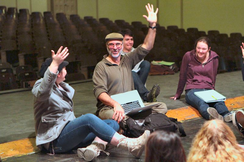 by: DAVID F. ASHTON - Cleveland High Schools drama instructor, Tom Beckett, checks to see that the cast of Guys and Dolls is ready to step up their rehearsal schedule if needed.