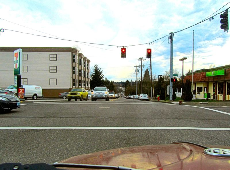 by: ERIC NORBERG - This shows the view of an eastbound driver on Tacoma Street waiting for a chance to turn left onto S.E. 17th. The left turn lane westbound is occupied. Notice that the two turning cars now do not face each other, which means that each turning car blocks the view of oncoming cars to the turning car on the other side of the intersection - so oncoming cars trying to beat the light might collide with the turning cars from the other side of the intersection, whose drivers dont see them coming.