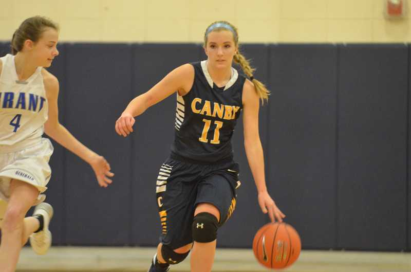 by: JEFF GOODMAN / FILE - Senior guard Ashley Evans scored a career-high 19 points as the Canby girls basketball team defeated Southridge at home March 4 to capture its first playoff win since 2007.