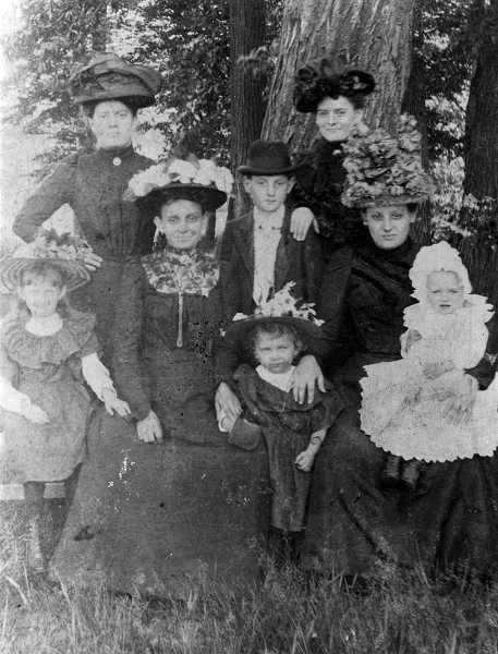 by: COURTESY PHOTO - De Carlos great-grandmother Anastasia Cervenka sits on the right with daughter Olga on her lap among other family members at an outing to Central Park.