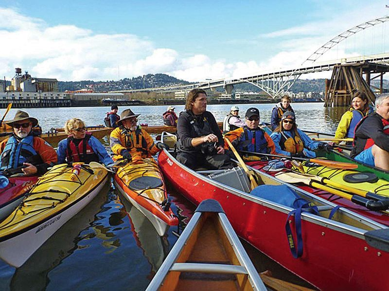 by: TRIBUNE PHOTO: STEVE LAW - Travis Williams of the Willamette Rivekeeper (center) leads a recent educational tour of the Superfund site in Portland Harbor for people on canoes and kayaks.
