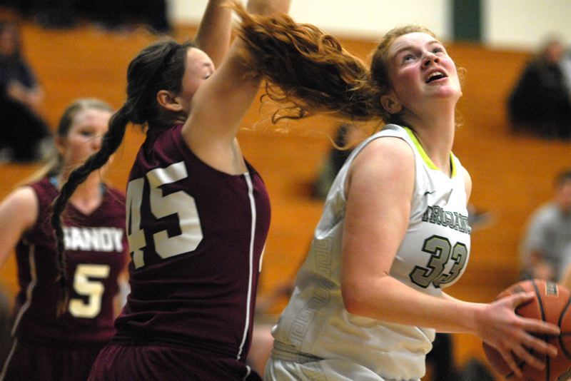 by: PAMPLIN MEDIA GROUP: DAVID BALL - Wilson center Nikki Hogan makes a move to the rim past Sandy's Mattie Burns during Tuesday's play-in victory.