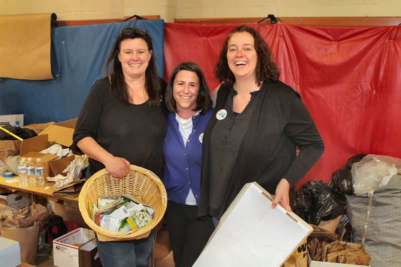 by: DAVID F. ASHTON - Two volunteers at the annual Meriwether Lewis Elementary School Rummage Sale - Julie Wallace, of Wallace Books in Westmoreland, and Cyndi Redmond - help PTA Co-President, Gina Ballard.