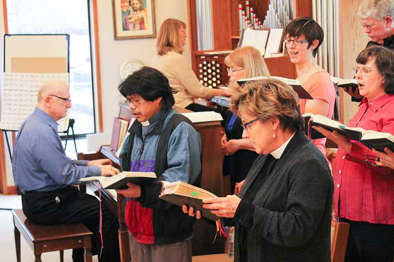 by: NEWS-TIMES PHOTO: JOHN SCHRAG - Vicar Julie Honig Smith (foreground) sings with the St. Bedes choir as members raised money during a March 2 hymn-a-thon.