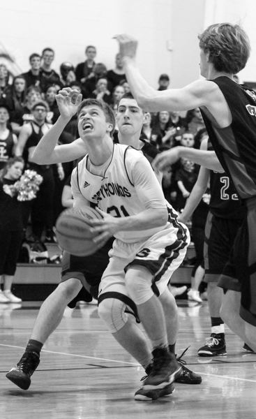 by: NEWS-TIMES PHOTO: CHASE ALLGOOD - Gaston senior Austin Morey drives into the lane during Saturday's game against Central Linn.