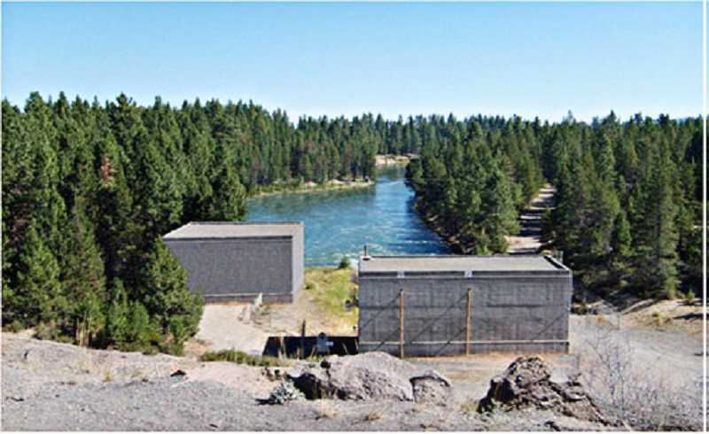 by: SUBMITTED PHOTO - The proposed power facility at Wickiup Dam, with a constructed building on the right, and artist's rendering of a second building on the left.