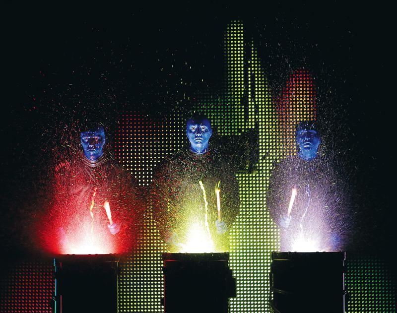 by: COURTESY OF BLUE MAN GROUP - The three humanoids of Blue Man Group like to create all kinds of noise with drums as part of their popular show, which plays Keller Auditorium, March 7 to 9.