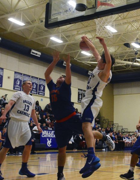 by: TIMES PHOTO: MATT SINGLEDECKER - Valley Catholic sophomore post Janek Falkenstein swats a Umatilla offering at the rim in the fourth quarter of the Valiants win on Saturday.