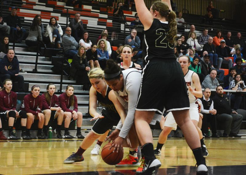by: TIMES FILE PHOTO - Southridge sophomore guard Lexie Dillon and the Skyhawks advanced to the first round of the 6A state playoffs by throttling Thurston on Friday.