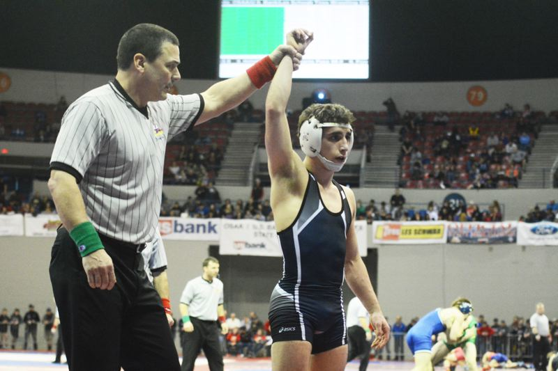 by: TIMES PHOTO: MATT SINGLEDECKER - Westview senior 120-pound Joel Timmons won the 6A state championship on Saturday, beating Oregon Citys David Poppen in a six-minute decision.
