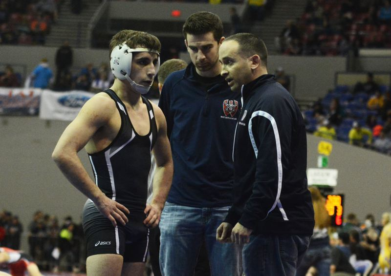 by: TIMES PHOTO: MATT SINGLEDECKER - Westview senior 120-pound Joel Timmons and head coach Matt Delaney worked together for four seasons  to put Timmons in position for his first state title.