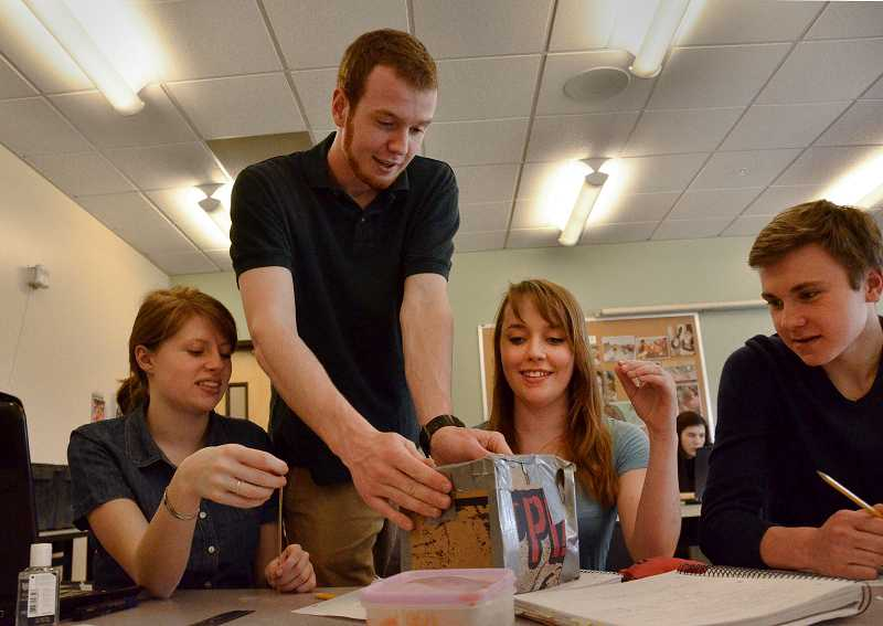 by: REVIEW FILE PHOTO: VERN UYETAKE - Riverdale graduate Logan Rooper (standing) began and taught a hands-on science class that kicked off in 2013 when he was a senior at the Portland high school. Students included, from left: Meg Scanlon, Patricia Torvalds and Hugh Halvorson.