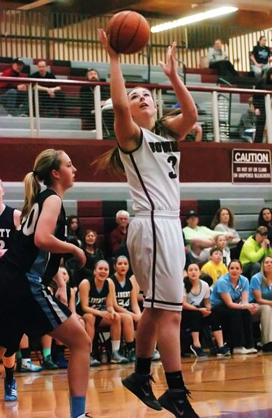 by: DAN BROOD - UP FOR TWO -- Sherwood senior Jaeyln Funk goes up to the basket during the Lady Bowmen's win over Liberty.