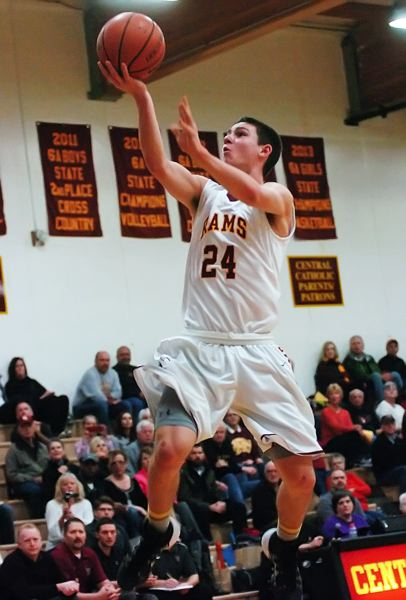 by: PAMPLIN MEDIA GROUP: DAN BROOD - Central Catholic sophomore Ben College goes to the basket.