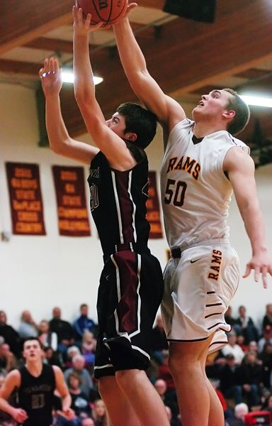 by: PAMPLIN MEDIA GROUP: DAN BROOD - Central Catholic junior Blake Brandel (right) blocks a shot by Tualatin sophomore Luke Osborn
