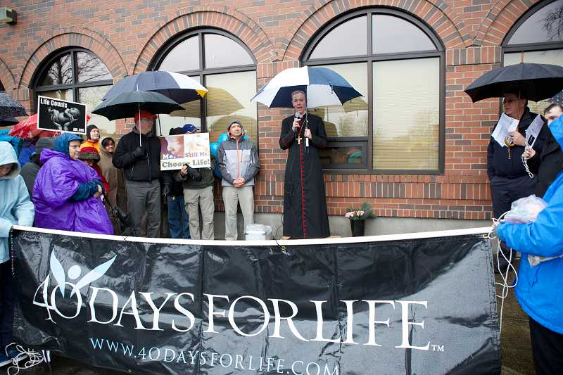 by: TIMES PHOTOS: JAIME VALDEZ - Archbishop Alexander K. Sample speaks during a '40 Days For Life' kickoff campaign in front of the Planned Parenthood clinic in Beaverton.