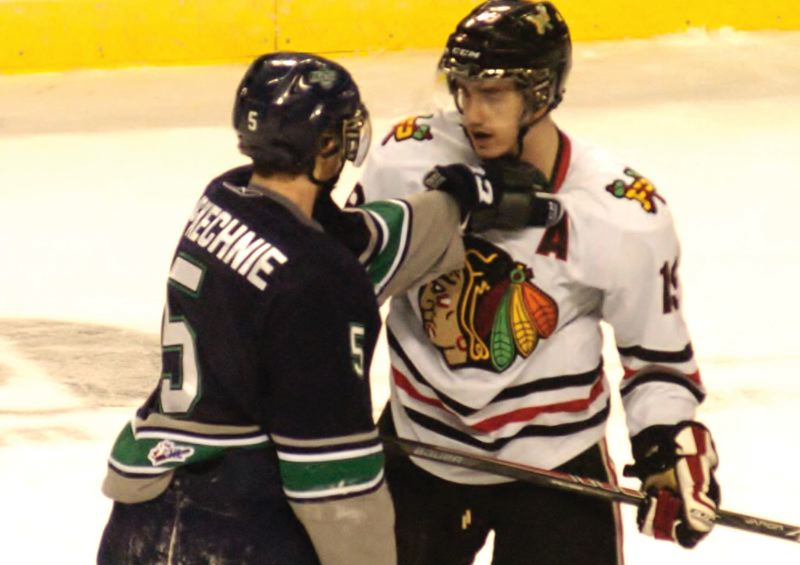 by: PAMPLIN MEDIA GROUP: PARKER LEE - Portland forward Nic Petan squares off against Seattles Sam McKechnie.