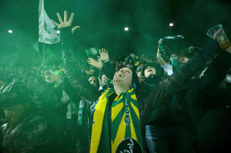 by: TRIBUNE PHOTO: JAIME VALDEZ - Timbers fans rejoice on account of their team's 1-1 draw.