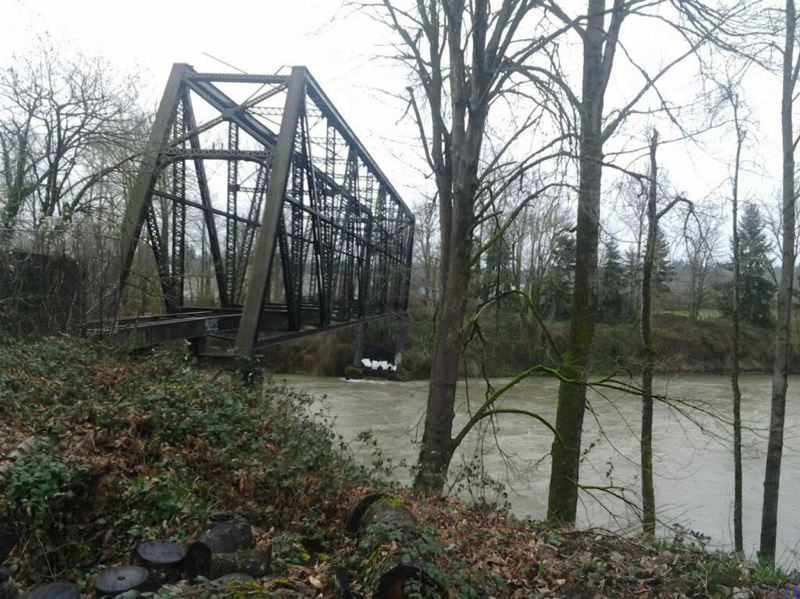 (Image is Clickable Link) by: COURTESY OF DICK SAMUELS OREGON PACIFIC RAILROAD CO. - The Portland Traction Co. trolley bridge over the Clackamas River in Gladstone began tilting Thursday, March 6, when erosion caused part of a piling to collapse. Heavy equipment began demolishing the old bridge on Sunday, March 9.
