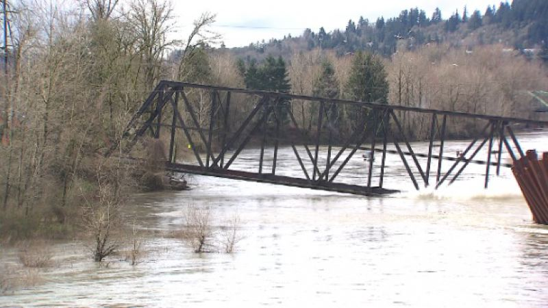 by: KOIN 6 NEWS - Just days after tilting significantly, the old trolley bridge over the Clackamas River is taken down Sunday.