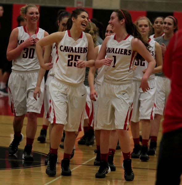 by: JON HOUSE - Clackamas players Erica Pagano (30), McKenzie Giancola (25) and Erin McDonald (1) celebrate with their teammates following Fridays 51-34 state playoff win over Tualatin.