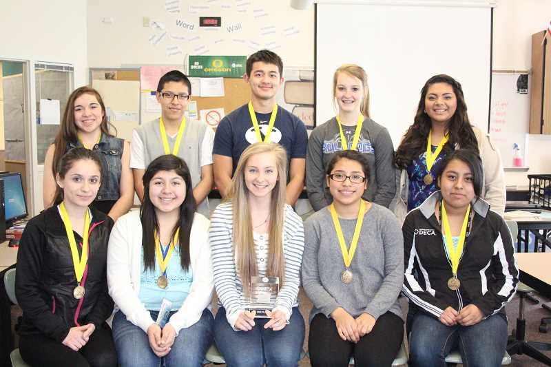 by: LINDSAY KEEFER - DECA students who ranked at state are (back row, from left) Kiana Thompson, Deni Cortez, Michael Te, Lizzy Ellingson, Evelyn Reyes, (front frow, from left) Alma Llamas, Michaela Vallejo, Sofia Seledkov, Kenia Benitez and Liz Cruz.