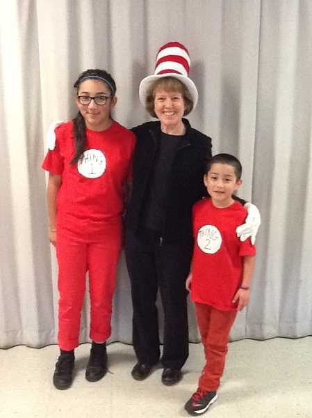 by: JUAN LARIOS - Student Anahi Velazquez (left), second-grade teacher Sheryl Rissberger and student Mario Velazquez dress up as 'Cat in the Hat' characters on character day at Washington Elementary.