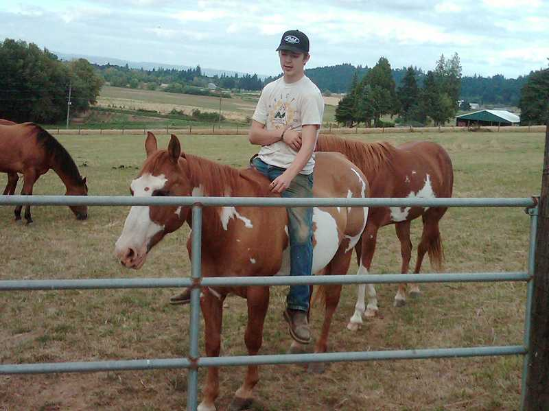 by: COURTESY PHOTO - A day rarely passed when Cody Fellows, 18, did not ride his Paint horse, Iggy, on his familys sprawling ranch on Fern Hill Road in rural Forest Grove.
