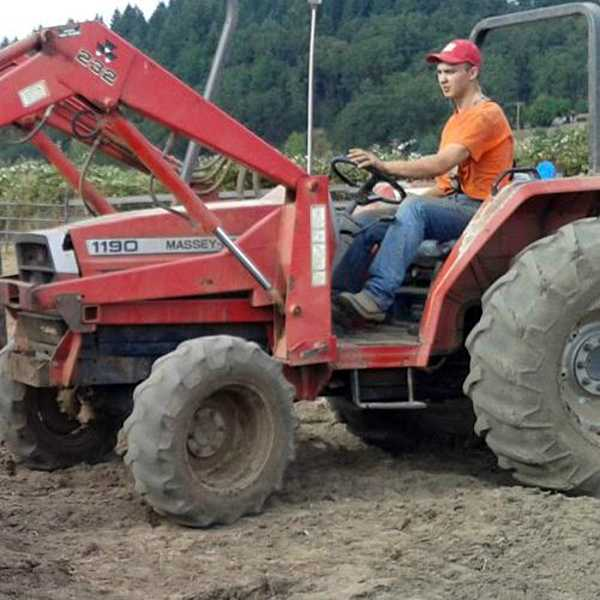 by: COURTESY PHOTO - One morning last fall when Cody Fellows missed the bus to Forest Grove High School, he hopped on his tractor and drove it to campus, where friends chuckled after he stuck a parking pass on it.
