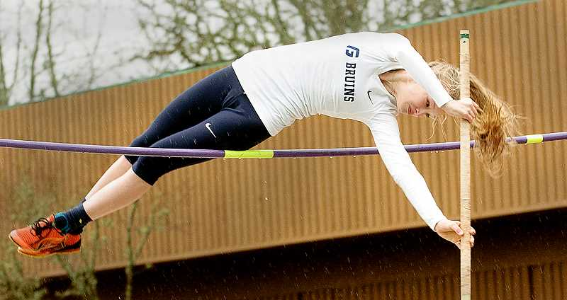 by: SETH GORDON - Over the hump - George Fox freshman Sierra Robertson clears the pole vault bar Saturday at the Rich Allen Classic. Robertson won the event with a mark of 10 feet.
