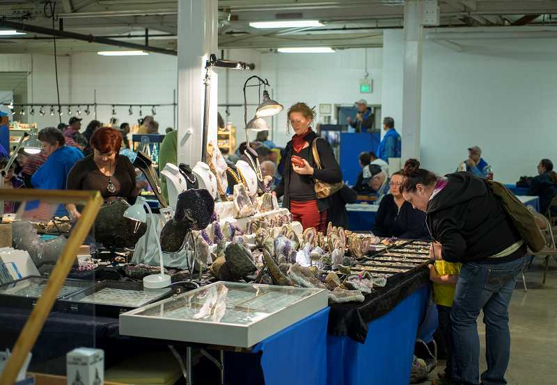 Visitors browse tables filled with rock and gem-related items at the county fairgrounds in Hillsboro. About 1,100 people turned out for the March 8 and 9 show.