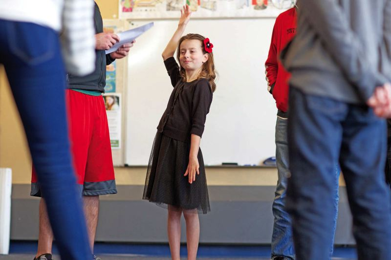 by: TRIBUNE PHOTO: JAIME VALDEZ - Fourth-grader Leila Hardy, 9, raises her hand to spell a word during an exercise at Beaverton's Village Home Education Resource Center. Hardy is representing the home-school center in the annual Portland Tribune/ Comcast Spelling Bee on Saturday at the Hollywood Theatre.