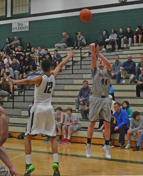 by: TIMES PHOTO: MATT SINGLEDECKER - Westview junior forward Alex Carrick scored seven points in the fourth quarter of the Wildcats playoff loss to Tigard last Wednesday.