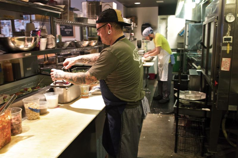 by: TRIBUNE PHOTO: JAIME VALDEZ - Two restaurants sharing a kitchen can yield efficiency. Here, Lardo cookT. J. Hansen works down the line from a Grass cook. The two restaurants sit next to each other in Portlands West End.