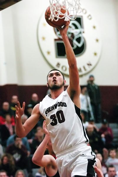 by: DAN BROOD - UP HIGH -- Sherwood senior Jordan Kurahara goes up to the hoop in the win over Silverton.