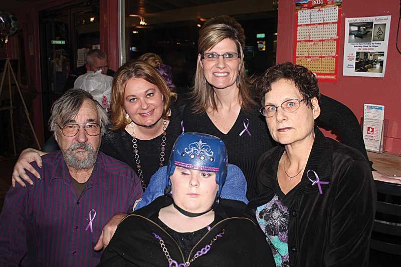 by: HOLLY M. GILL - Jessica Haynes is flanked by her parents, David and Joanne Haynes, with sisters Melissa Schonneker (back left) and B.J. Heckathorn behind her.