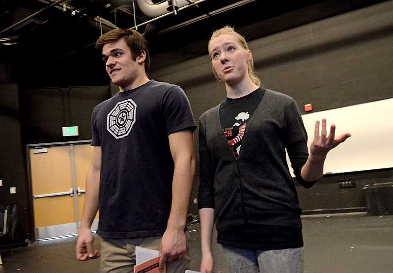 by: REVIEW PHOTO: VERN UYETAKE - Lakeridge students Quinn Milionis, senior, left, and Sam Wolf, sophomore, rehearse I Think You Think I Love You, directed by Jesse Johnson.